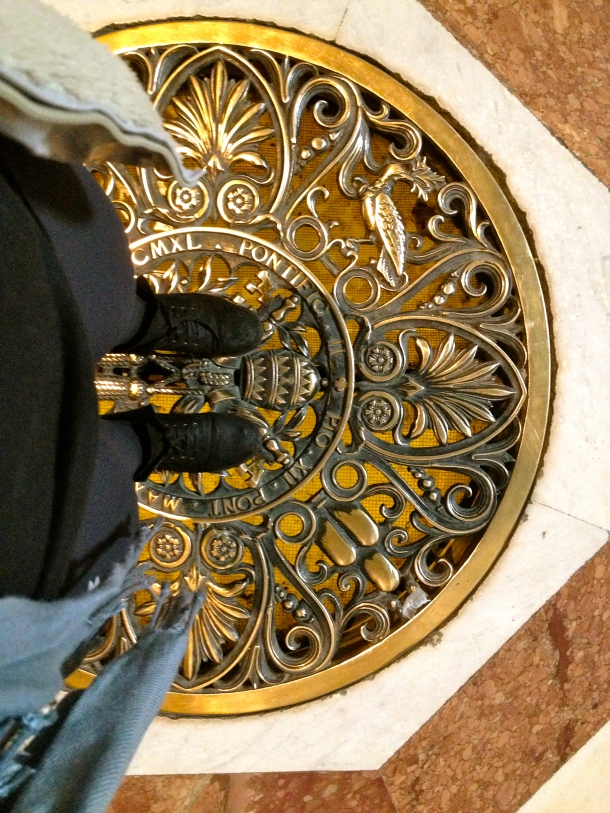 Standing in St. Peters Basilica--beneath this grate are the Papal Grottoes and a level under that were the excavations we saw.
