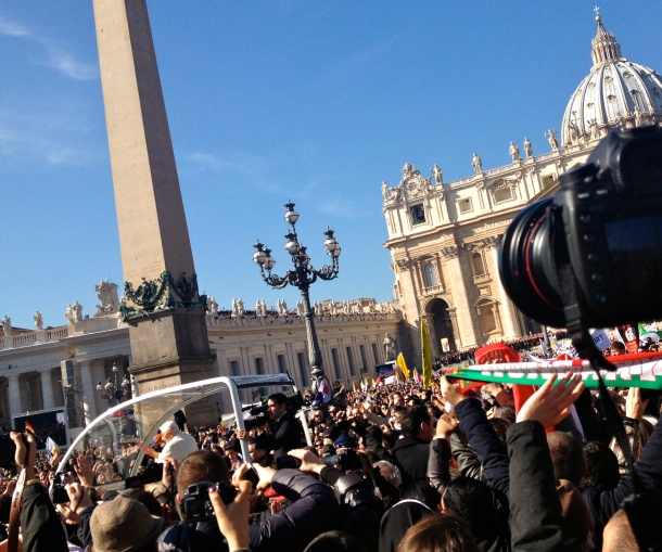 Benedict riding in the Popemobile before his last appearance at the Vatican.