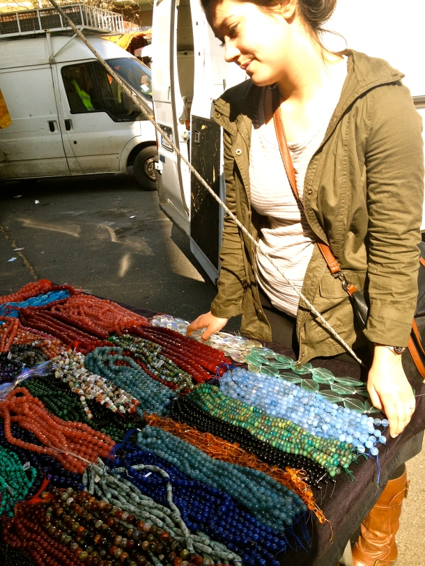 Carmen in bead heaven at the Sunday flea market.